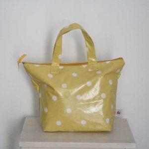 Kuferek żółty w grochy